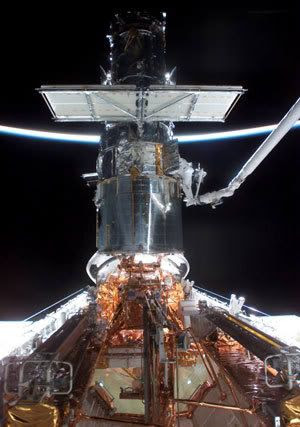 An astronaut works on Hubble during the last service mission, which took place with space shuttle Columbia on 2002's STS-109 flight.