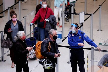 2 million people board U.S. flights for the first time since the pandemic started.