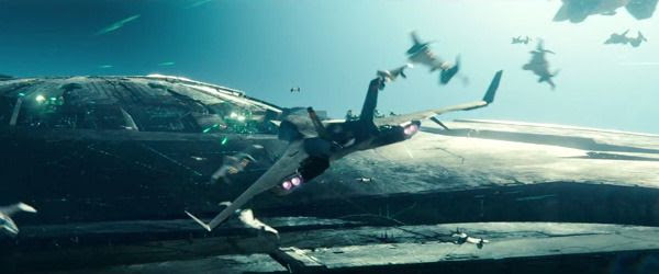 Alien-hybrid jet fighters engage in an intense air battle above the alien mothership in INDEPENDENCE DAY: RESURGENCE.