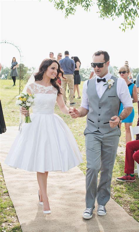 Grey and yellow theme wedding. Short wedding dress. Bow
