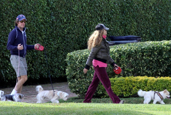 "Nicolas Vallejo Najera Paulina Rubio and husband Nicolas Vallejo Najera ""Colate"" take their dogs for a walk."