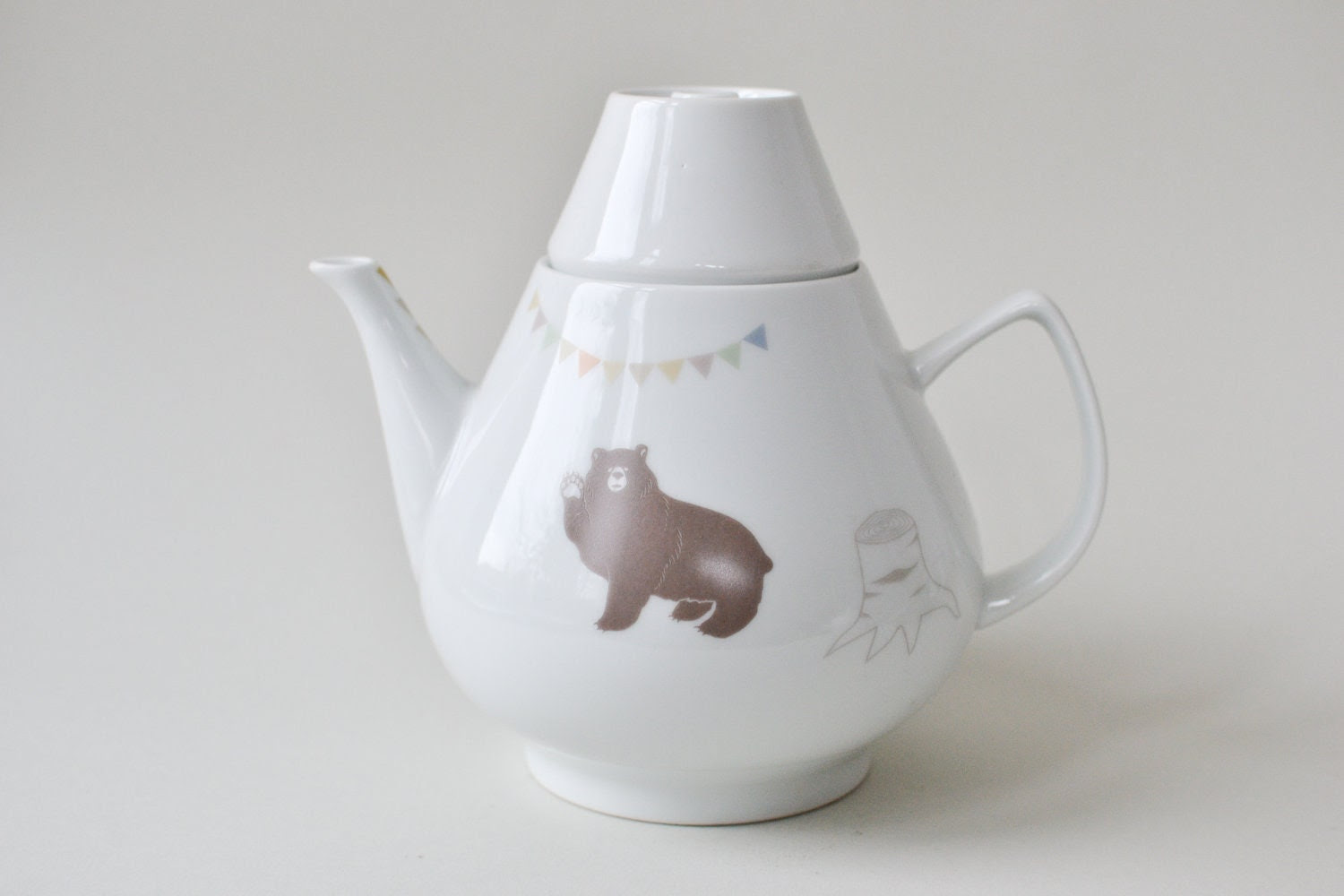 Big fun vintage teapot with bears, trees and banner