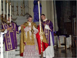 Photograph of a traditional priest incensing the easter candle