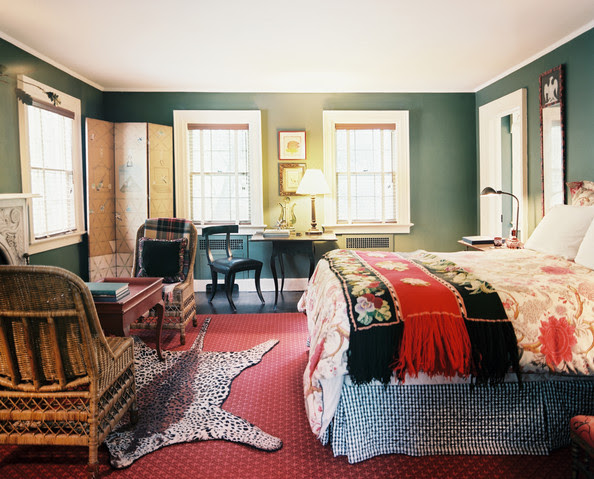 Bedroom - A mix of patterns in a green-walled bedroom