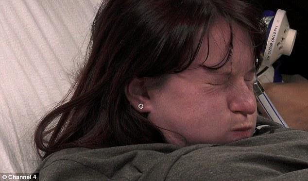 As Amy pushes through a particularly difficult contraction enouraged by the midwife she goes blue in the face