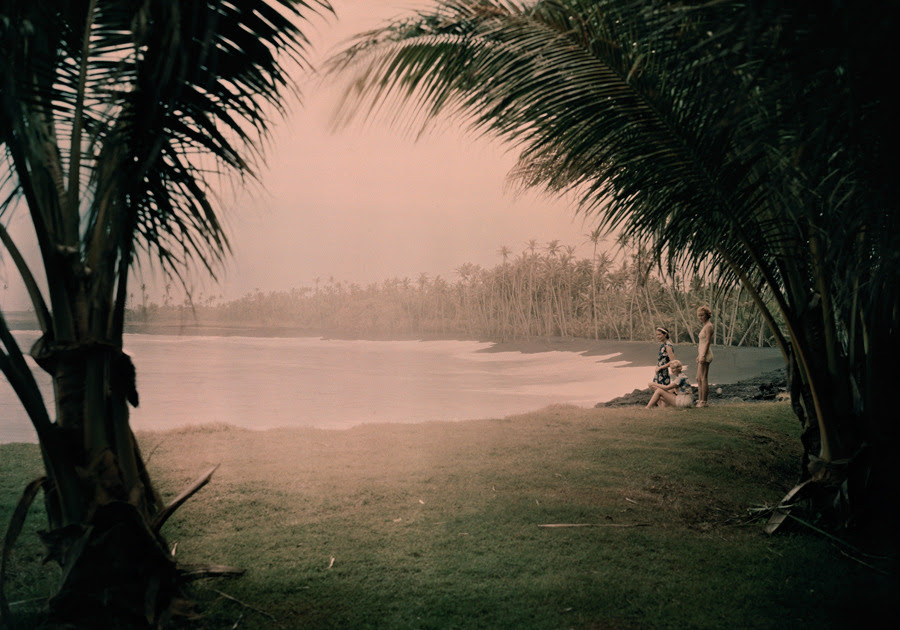 Young women look out on Kalapana Black Sand Beach in Hawaii. The beach gets its black color from volanic lava, November 1937.Photograph by Richard Hewitt Stewart, National Geographic