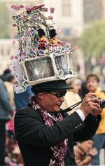 Cameraman (Associated Press / April 29, 2011) Multimedia artist Chito Salarza-Grant wears a royal wedding-themed hat in central London.