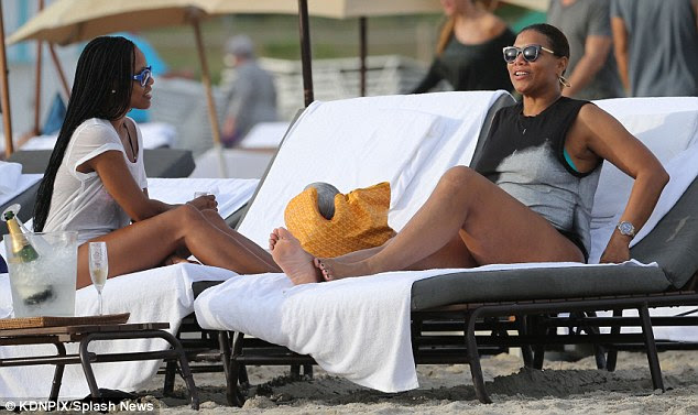 Kicking back: Latifah relaxed on a beach chair