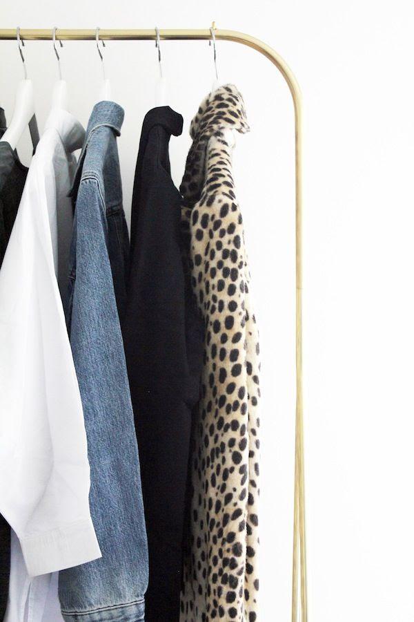 Le Fashion Blog Stylish Open Closet Gold Clothes Rack Leopard Coat Jean Jacket White Shirt Fashionable Home Decor Interior Design Jenn Camp