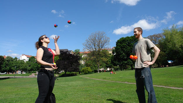 Woman attempting to juggle