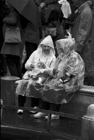 Ladies in raincoats