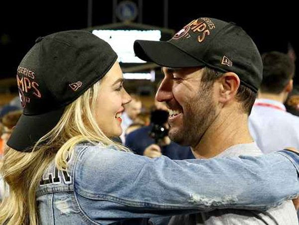 Supermodel Kate Upton and her fiancé/Astros pitcher Justin Verlander share a moment after Houston won the World Series at Dodgers Stadium...on November 1, 2017.