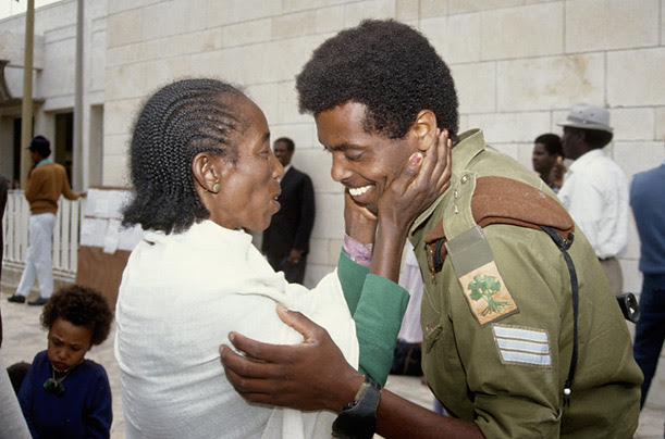 A sergeant in the Israeli army greets a relative, newly arrived from Ethiopia, 1991