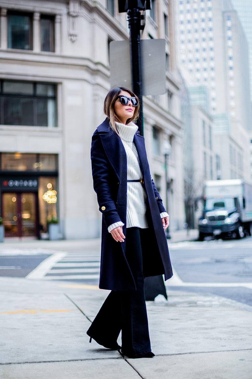 Pam Hetlinger, The Girl From Panama wearing an h&m navy coat, celine sunglasses, thin belt, mango flare jeans, white turtleneck sweater and chloe georgia bag.