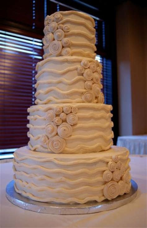 4 tier tan wedding mocha cake with swirls and lines
