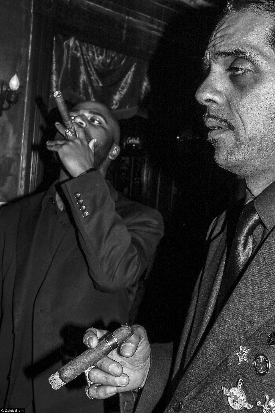 Residents Danny and Michael are pictured smoking cigars at Joe Netherworld's Satanist 'Winter Frolic' Party on Clinton Street in Poughkeepsie