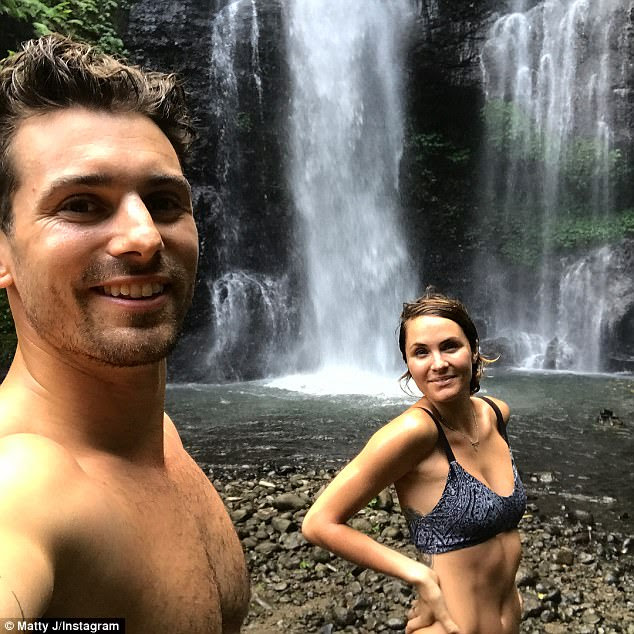 Chasing waterfalls! The Bachelor's Matty J and Laura Byrne flaunt gym-honed physiques in swimwear as they continue romantic getaway in Bali