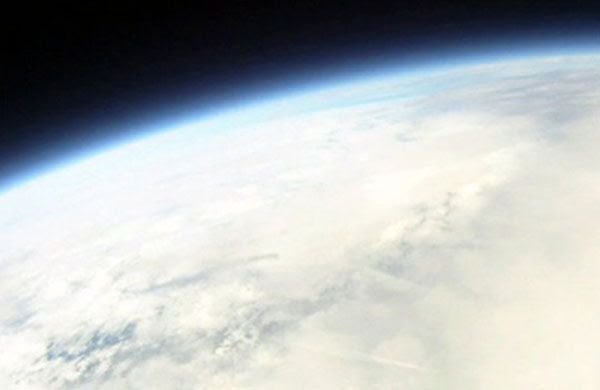 The curvature of the Earth...as seen by a video camera attached to a weather balloon flying 100,000 feet off the ground.