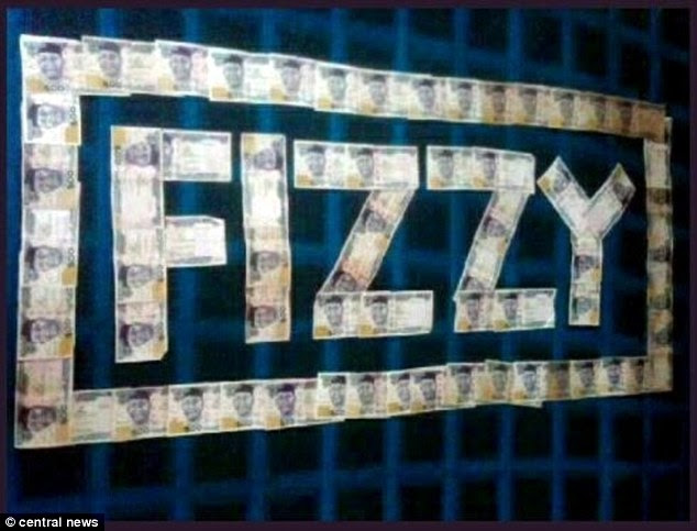 Pictured is Frank Onyeachonam's nicknamed 'Fizzy' displayed in bank notes