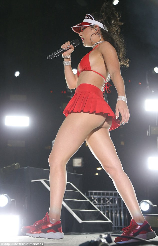 Ease of movement: Charli sported a pair of red and black trainers to help her prance around the stage