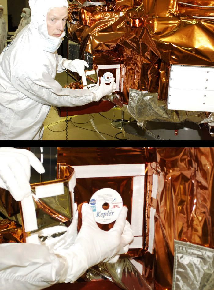 A Ball Aerospace technician prepares to attach the 'Name In Space' DVD onto the Kepler spacecraft.