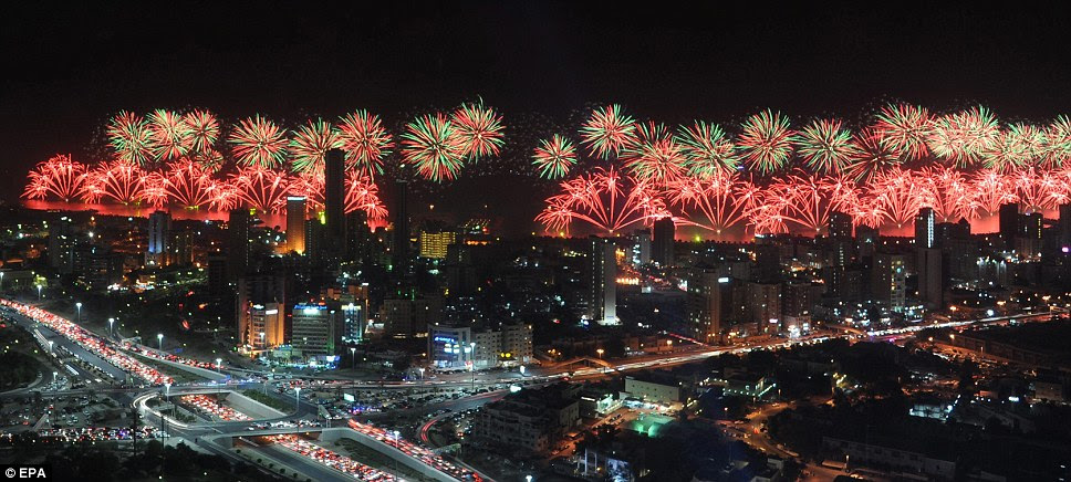 Exploding fireworks illuminate the sky over Kuwait City, Kuwait, last night, during celebrations on the occasion of the 50th Constitution Day jubilee