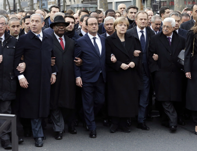 The French President François Hollande is surrounded by heads of state; Paris; January 11, 2015.