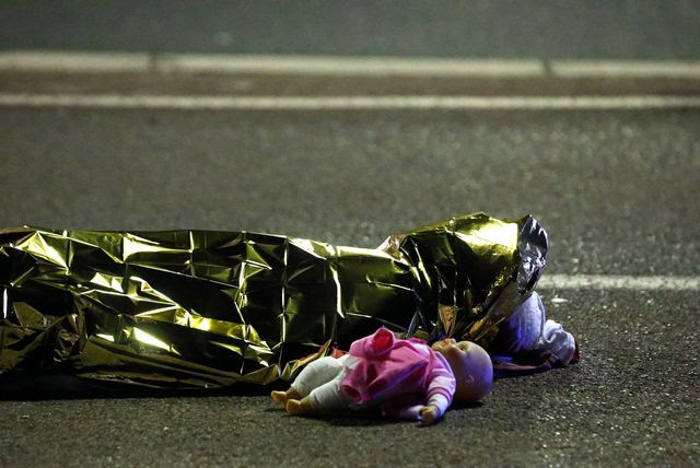 a body on the Promenade des  Anglais in Nice, after the attack of a madman  truck that left at least 77 dead on 14 July.