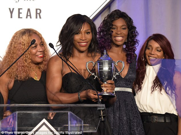 Family affair: Also sweetly supporting the Wimbledon diva onstage were her mother Oracene Price and older sisters Venus Williams and Lyndrea Price