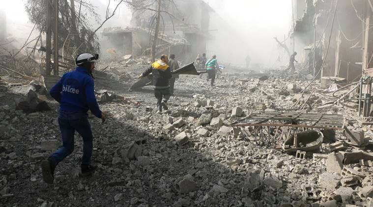 Syrian activists say shelling of Damascus suburb killed 98 people