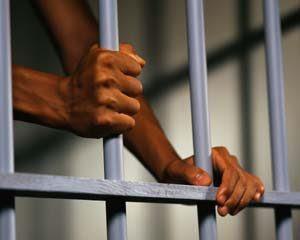 Prisoner's Hands Holding Bars ca. 2000