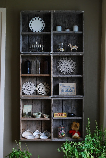 great use of wooden crates. I like the color of the crates and the wall