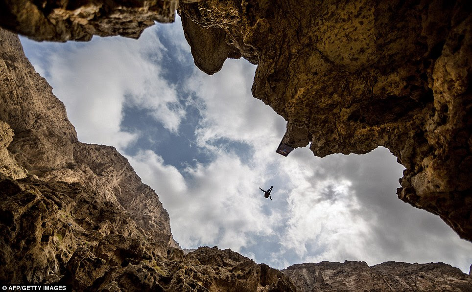 Brave Michal Navratil of the Czech Republic launches himself off the 88ft cliff in the valley