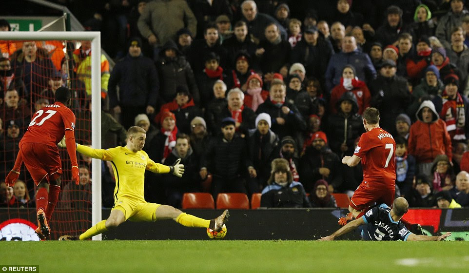 Man City's England No 1 Joe Hart comes sprawling out of the goal but is unable to deny Milner's shot which hit the post on the way in