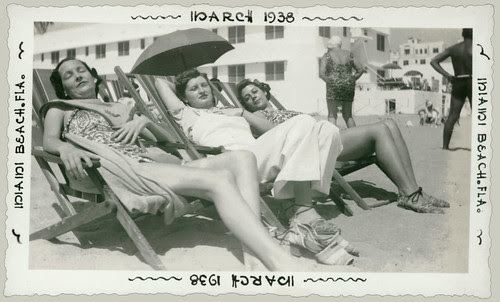 Three women asleep on the beach