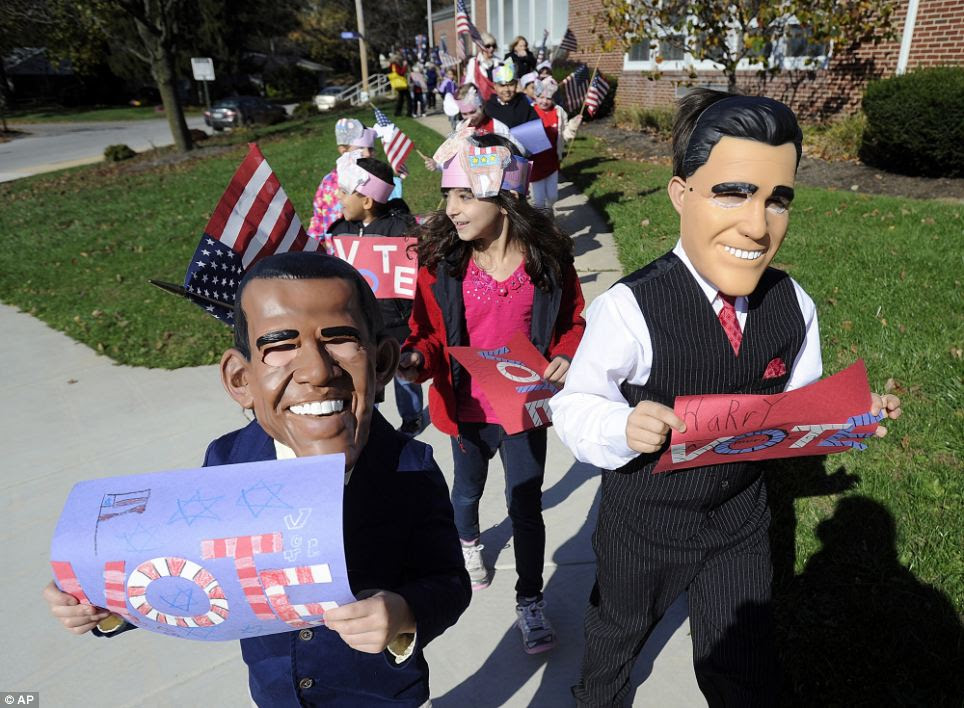 In the spirit: Second-graders Brayden Gentzyel, left, as Obama and Harry Perkins, right, as Mitt Romney, from Valley View Elementary School in the York, Pennsylvania lead a parade of students around the school to encourage people to vote