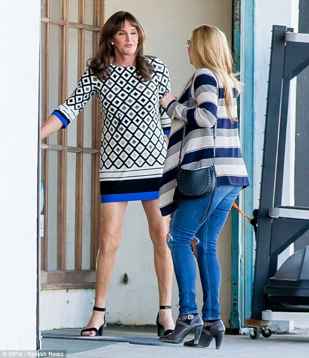 Best pals: Caitlyn, 66, gallantly held open the door for her friend and fellow transgender icon Candis Cayne, 44, as the pair went shopping after enjoying a spot of lunch together
