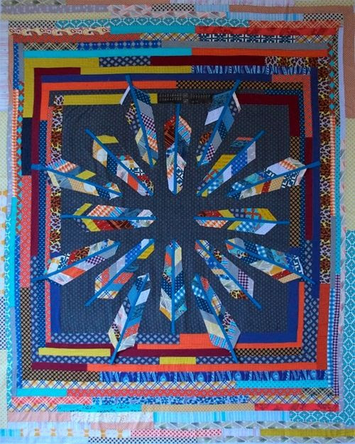 patchwork quilt top with appliquéd scrappy feathers by anna maria horner