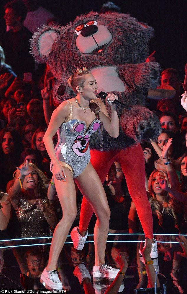 Centre stage: Miley's fans went crazy as the 20-year-old singer hit the stage at the MTV VMAs