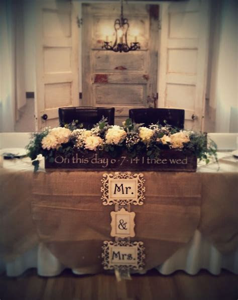 Head table backdrop of vintage doors and chandelier with