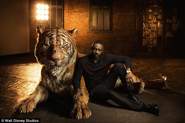 Not to be trifled with: Idris Elba looked relaxed for a man leaning up against a giant, Bengal tiger, though of course the CGI image represented his character Shere Khan, who 'reigns with fear' and has it out for Mowgli due to his 'hatred of humans'
