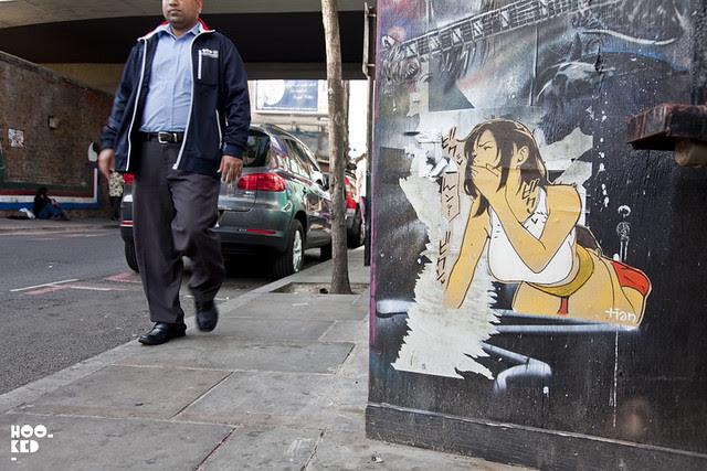 French Street Artist Tian installs work in London.