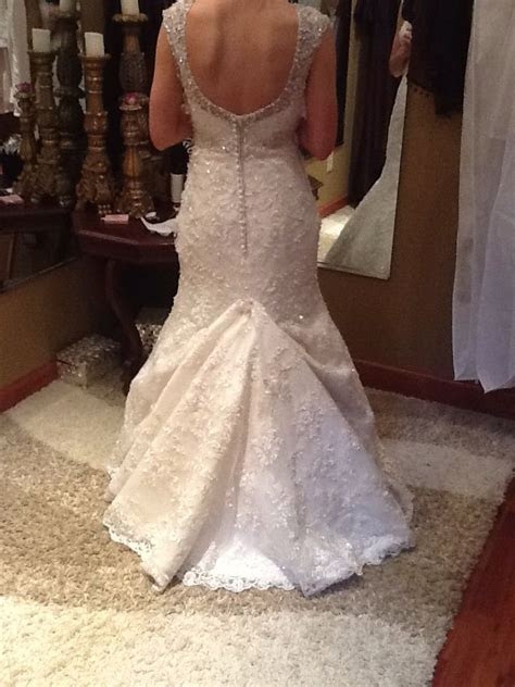 over bustle with a mermaid style lace wedding gown