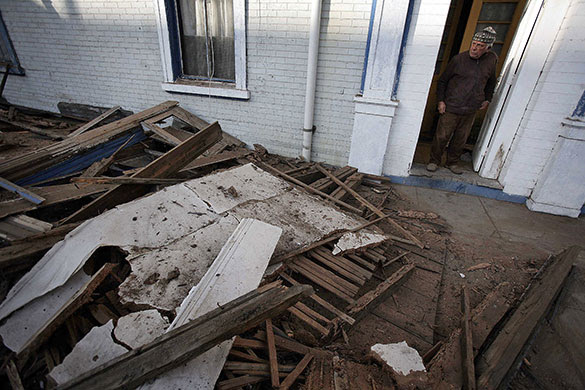Chile Earthquake: A man looks at the debris outside his house in Valparaiso