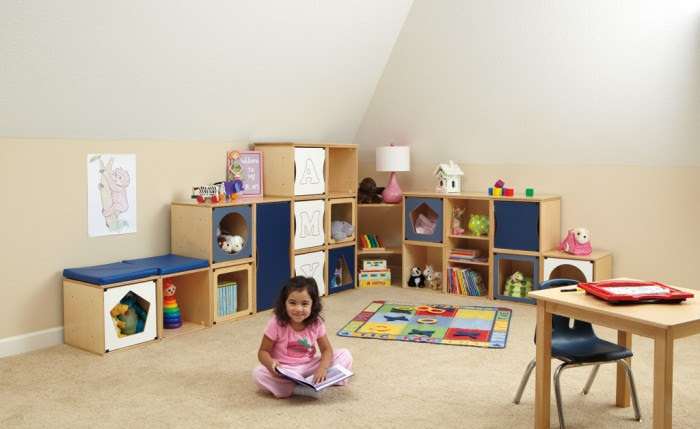 A perfectplay room.com Clean palette natural wood and navy storage units Attic style