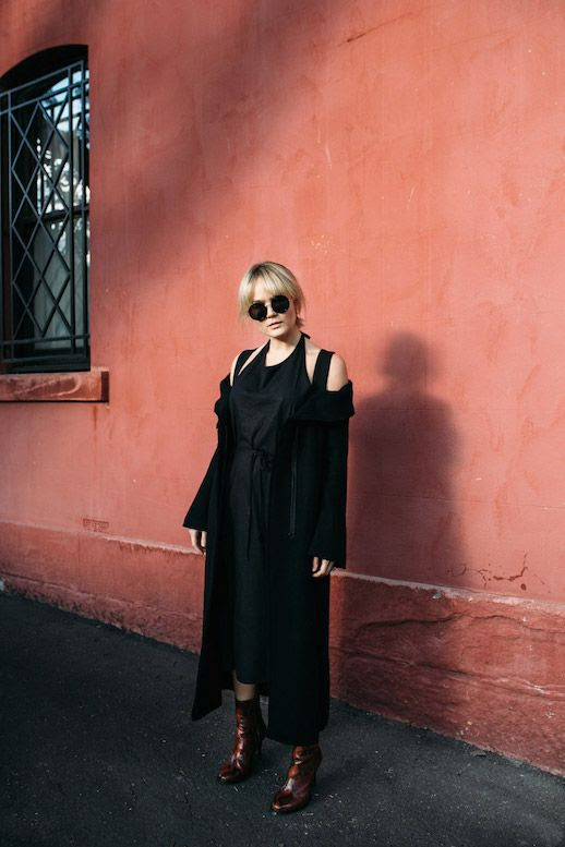 Le Fashion Blog Black Halter Dress Black Long Coat Patterned Boots Round Sunglasses Via Brooke Testoni