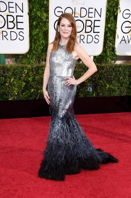 Perhaps one of the most admired look from the red carpet! Julianne Moore looked stunning in a custom Givenchy gown. The sequin and feather f