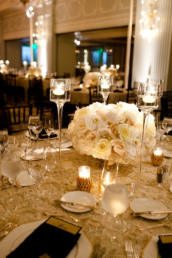 Gorgeous centerpiece and floating candles - warm & wonderful glow!    Photography by docuvitae.com, Design and Production by kristinbanta.com