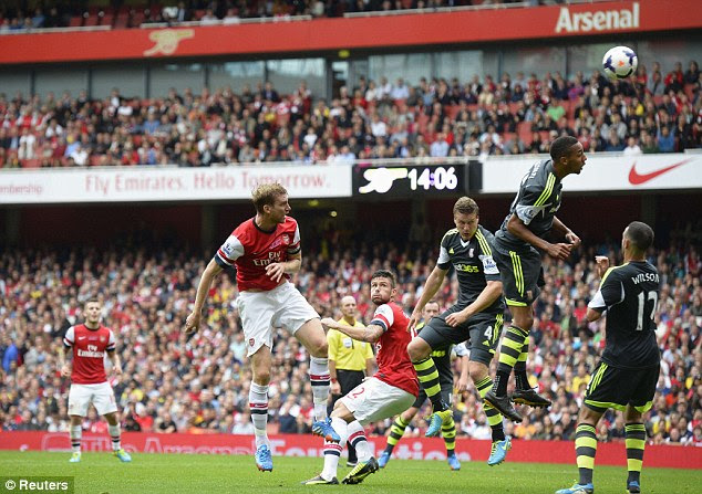 Heads up: Per Mertesacker jumps to head in a goal against Stoke to re-gain the lead for Arsenal