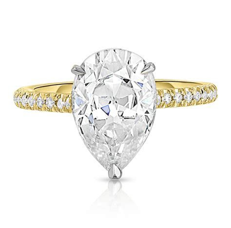 PEAR SHAPE MOISSANITE TWO TONE RING